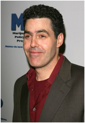 "Let's put it this way: I now have an ""Adam Carolla is racist"" file photo."