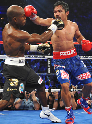 Pacquiao delivering a counter-punch to Bradley. This pretty much sums up the entire fight in a single image.