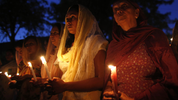 Members of the Wisconsin Sikh community held a candlelit vigil after six Sikhs were brutally murdered at a temple in Oak Creek, Wicsonsin.