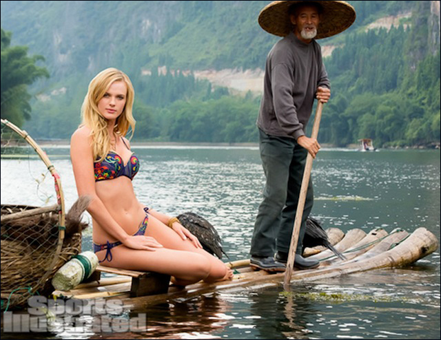A model is pictured above in a bikini with a Chinese fisherman as an ethnic prop.,