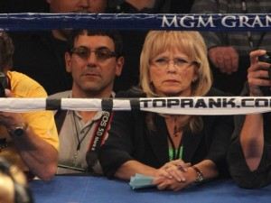CJ Ross, sitting ring-side at a fight, as a judge.