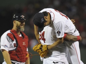 David Ortiz lifts up relief pitcher Koji Uehara after the Red Sox's Game 2 victory over Tampa.