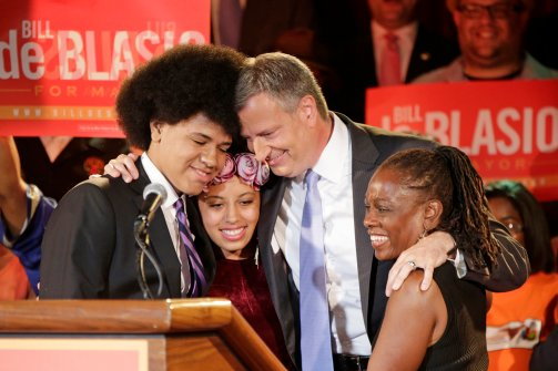 Bill de Blasio hugs his family during his victory speech last night.