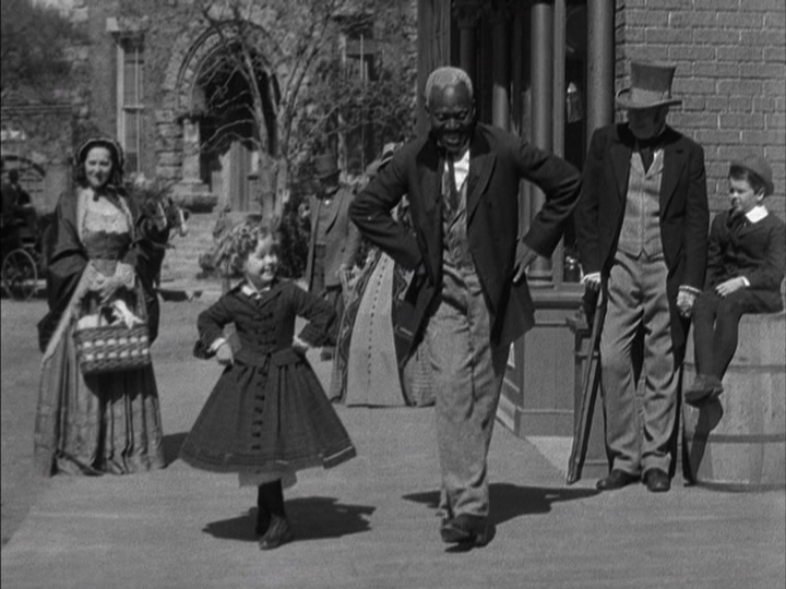 "Shirley Temple's character dances with her slave, Uncle Billy, in ""The Littlest Rebel"" (1935)"