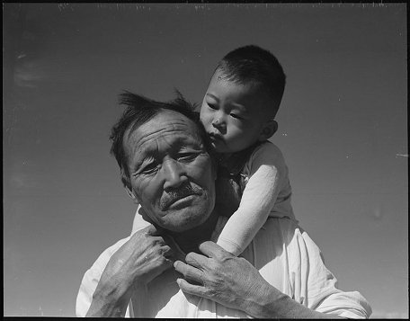 Grandfather and child, at Manzanar. Photo credit: Dorothea Lange.