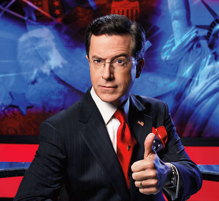 Stephen Colbert has carefully orchestrated a persona, and uses many forms of physical and verbal comedy to reinforce the exaggerated nature of his character. This suit, the eyebrow, the thumbs-up sign: they are careful exaggerations designed to both invoke and parody a very specific Fox News-esque persona.
