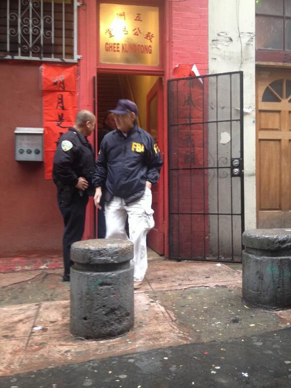 FBI standing outside of the Ghee Kung Tong Stone Temple in San Francisco's Chinatown, home of the Chinese Freemasons. (Photo credit: @sfkale/Twitter)