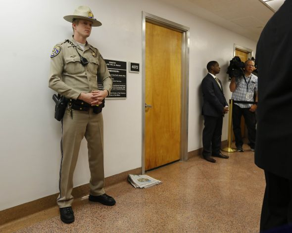 State troopers stand guard in front of Senator Yee's office at the State Capitol. (Photo credit: AP/Rich Pedroncelli)