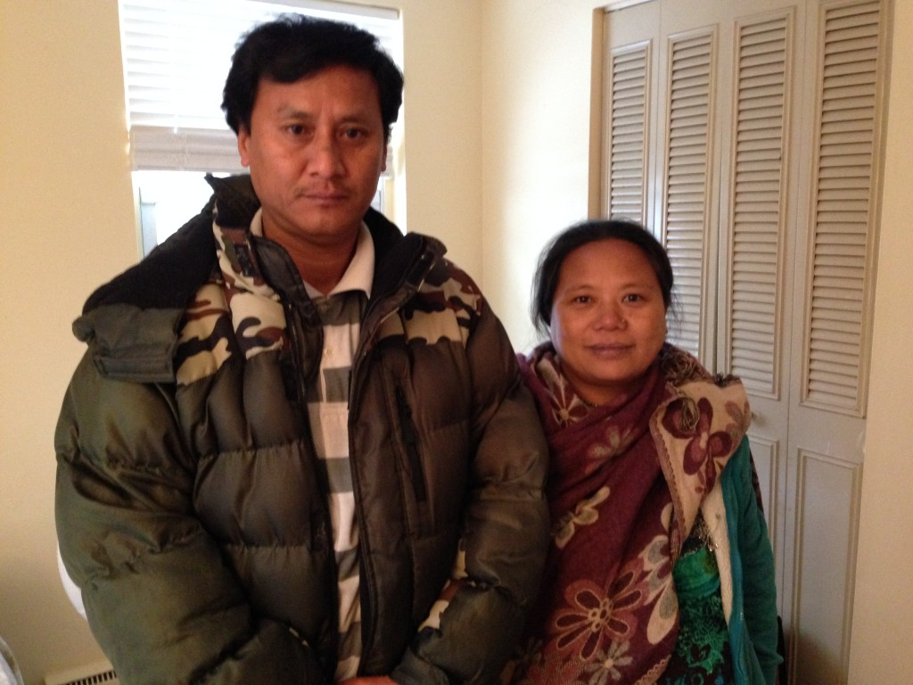 Bhutanese American Tara Gurung and her husband. Tara's father, Ram Gurung, counseled fellow refugees from committing suicide. However, after moving to the United States with his wife and two adult daughters, Ram Gurung committed suicide last year at the age of 73. (Photo credit: Ryan Lessard, NHPR)