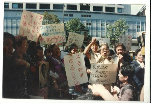 "Lola Fidencia David (center) a former ""comfort woman"" from the Phillipines at a rally held in 1993 surrounded by other survivors; the protesters were seeking acknowledgement and compensation from the Japanese government. Their case was ultimately dismissed.  (Photo credit: HumanRights.ca)"