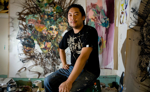 Artist David Choe along with some of his work. Photo credit: NY Times