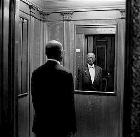 Harold Hancock, an elevator operator. Throughout the early twentieth century, the most high-paying jobs that African Americans could attain were as ceremonial servants for White America -- doormen, butlers, stevedors, and elevator operators. This is an image of Black America that Steve Rogers would be used to; how he missed the entirety of the Civil Rights Movement with no lasting consequences is the major conceit of the Captain America movies ... and one that needs to be corrected or addressed.