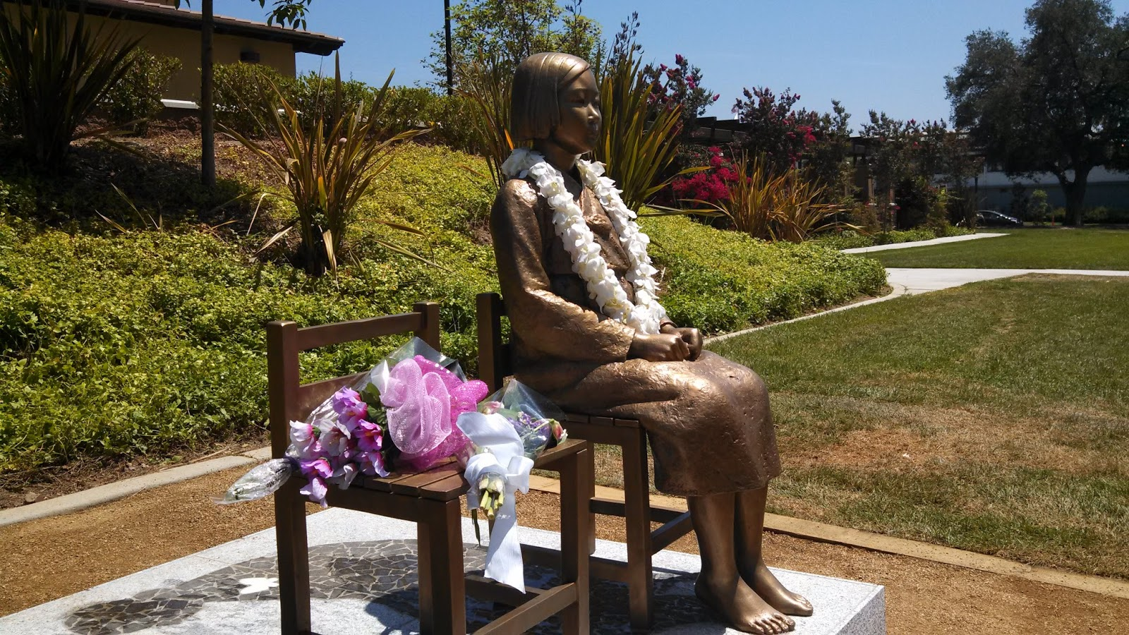"A photo of a memorial statue honouring the thousands of WWII ""comfort women"" victims who endured sexual slavery at the hands of the Japanese Imperial Army."