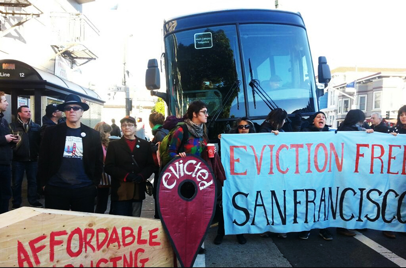 Protesters protest gentrification of San Francisco by large tech companies through a street protest of the Google bus. (Photo credit: Dan Hirsch.)