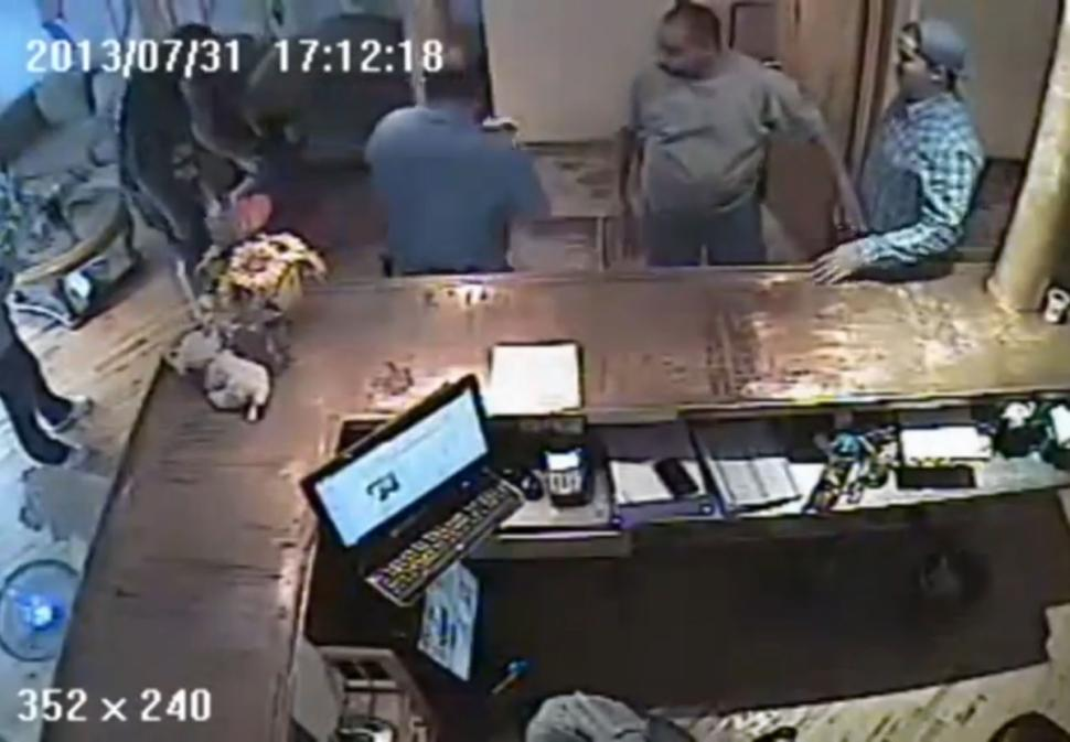 "Screen capture of suveillance video showing Jianqing ""Jessica"" Klyzek's arrest (upper left)."