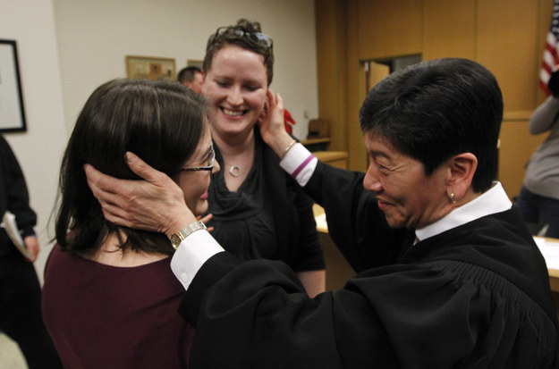 Yu officiates the marriage of Emily (left) and Sarah Coffer on December 9, 2012. (Photo credit: AP / Elaine Thompson)