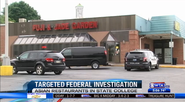 Authorities raid Fuji & Jade Garden in State College, PA yesterday as part of a 9-restaurant raid of Asian businesses. (Screen capture: WTAJ)