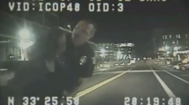 Screen-capture of dashcam video showing Officer Stewart Ferrin screaming at ASU professor Ersula Ore moments before he throws her to the ground.