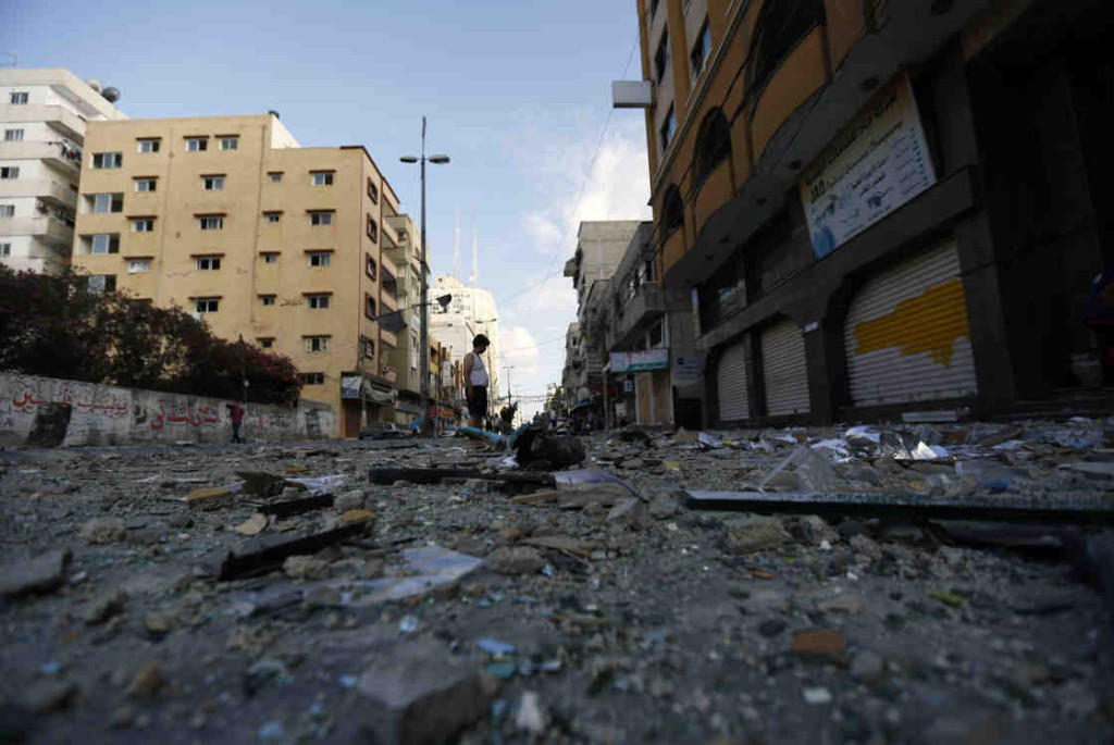 In Gaza City, a Palestinian man stands amid debris after an Israeli airstrike. (Photo: Mohammed Abed/AFP/Getty Images)