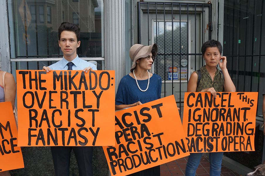 "Providence, Rhode Island residents protest Opera Providence's recent yellowface staging of ""The Mikado"". (Photo credit: James McShane)"