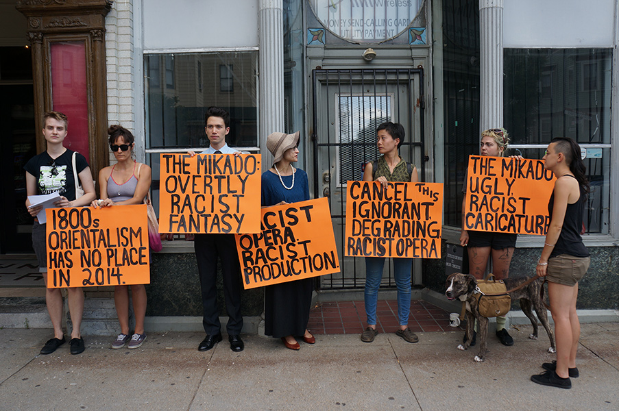 "Protesters stage a peaceful protest of ""The Mikado"" by Opera Providence in Rhode Island. (Photo credit: James Glantz)"