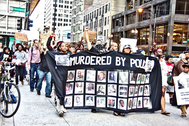 A protest in Chicago against police brutality in the wake of Mike Brown's killing. (Photo credit: Flickr / Mikasi)