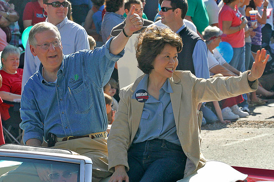 Senate Minority Leader Mitch McConnell and Elaine Chao at a campaign event. Photo credit: AP