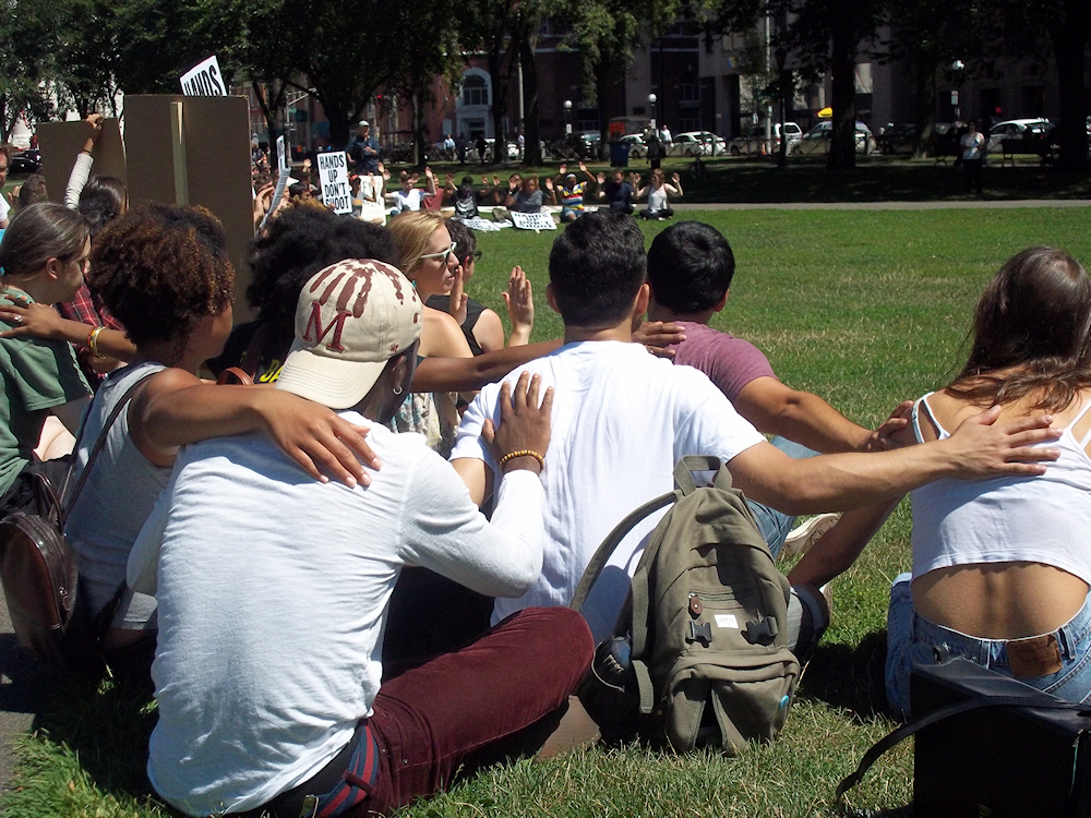 Approximately 200 students and New Haven residents gather on the New Haven Green for an August 19th peaceful protest in solidarity with the residents of Ferguson. (Photo credit: Reappropriate)
