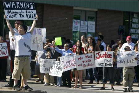 Protesters stage a street protest in 2009 in response to the shooting death of Hmong American youth Fong Lee.