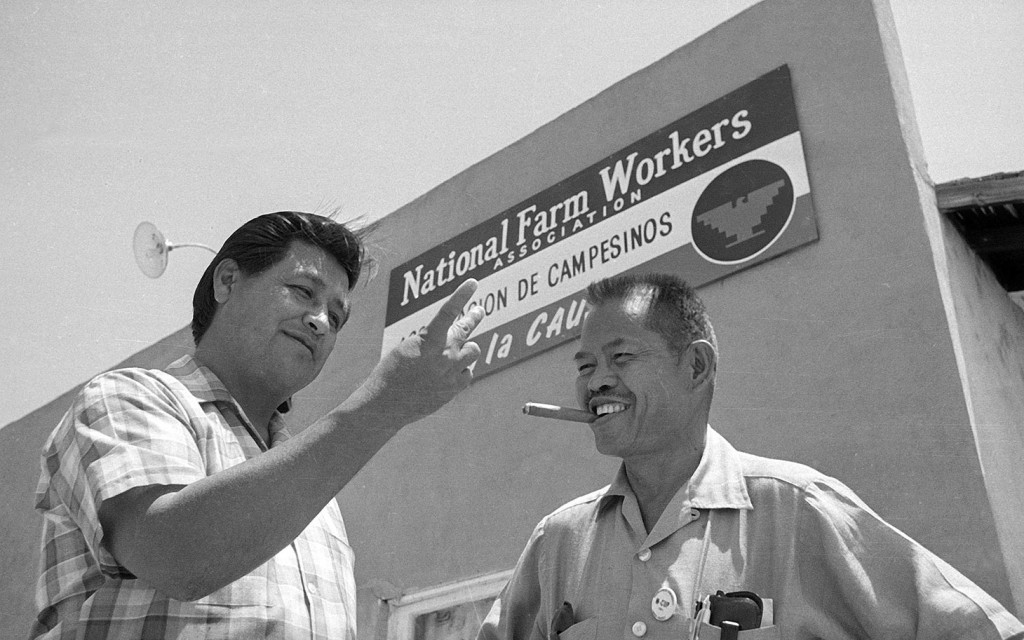Larry Itliong stands alongside Cesary Chavez in front of NFWA headquarters in July 28, 1967. (Photo credit: AP Photo/ Harold Filan)