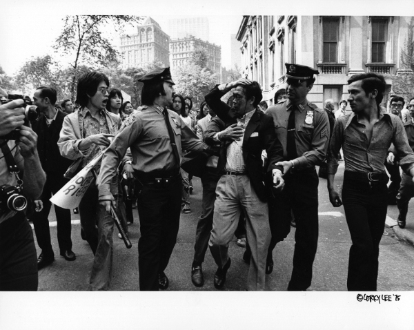 An iconic image of a police brutality victim in 1975, photo by Corky Lee.