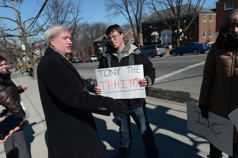 Senator Tony Avella is protested at a campaign event by a small group for his switch to the Independent Democratic Conference (IDC). (Photo credit:  Debbie Egan-Chin / New York Observer)