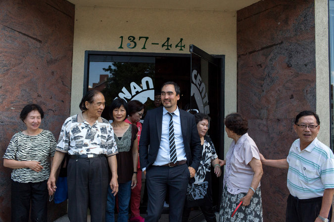 Tim Wu campaigns in New York City's Flushing-area Taiwan Center. (Photo credit: Andrew Renneisen/The New York Times)