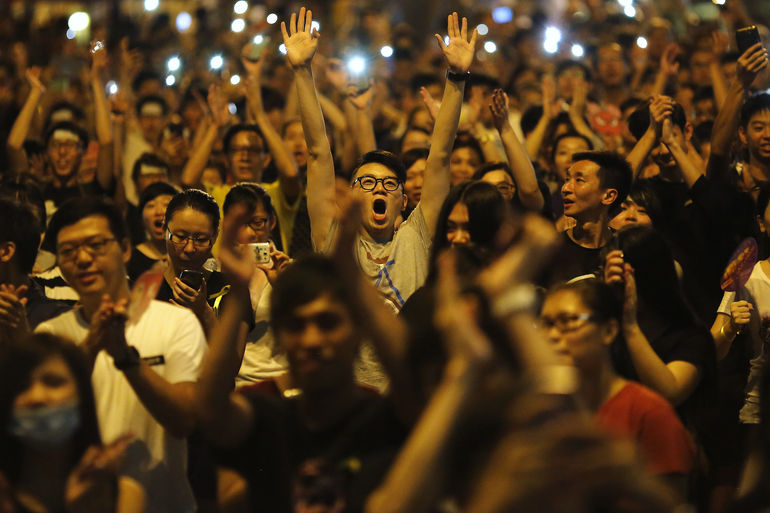 "Occupy Central protesters have reportedly even drawn inspiration from Ferguson protests, with protesters reportedly raising their hands and chanting ""hands up, don't shoot"" in response to police tactics that are reminiscent of the police response in Ferguson."