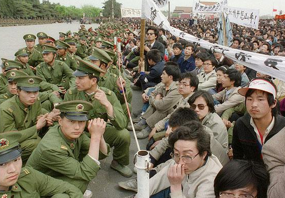 College-aged pro-democracy protesters defy police at Tiananmen in 1989. (Photo credit: AFP)