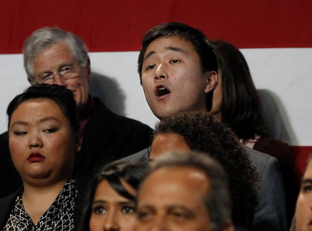 Immigration rights activist Ju Hong heckles the president, demanding action on immigration reform.