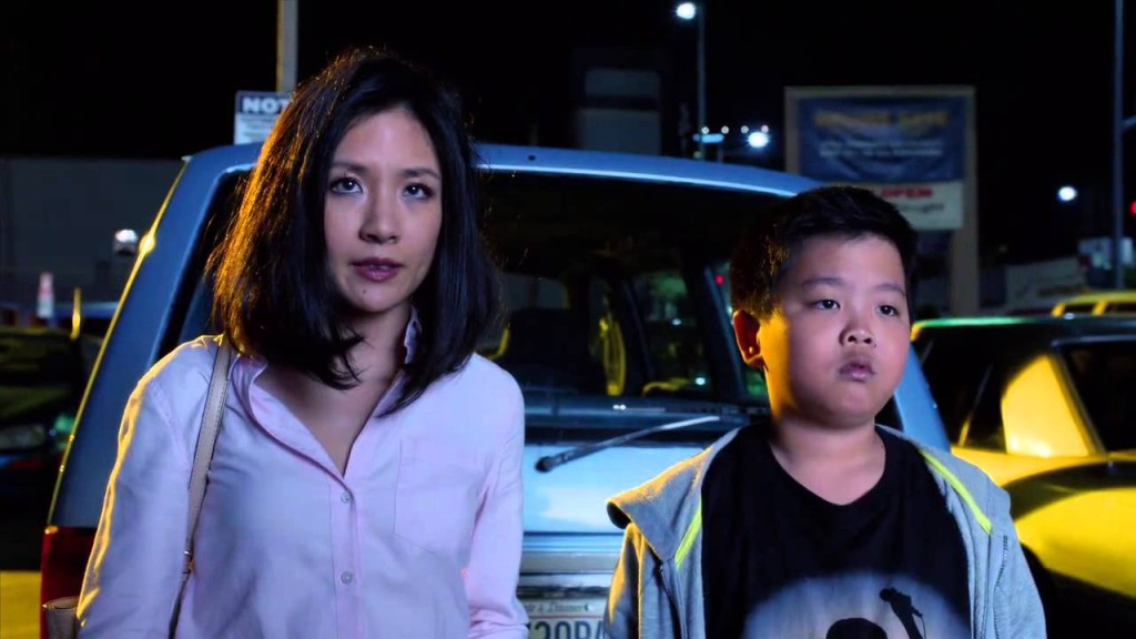 Constance  Wu as Jessica Huang with Hudson Yang, playing Eddie.
