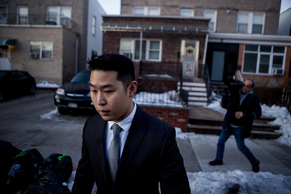 Officer Peter Liang leaves his home in Brooklyn. Photo credit: Sam Hodgson / New York Times