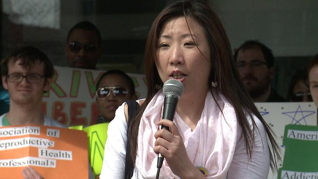 Bei Bei Shuai, who lost her fetus following an unsuccessful suicide attempt, at a rally. Photo credit: Ms. Magazine
