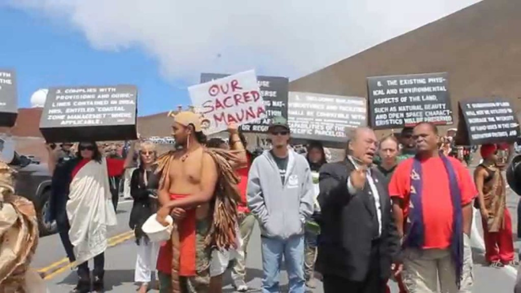 Protesters march to protect the summit of Mauna Kea from a construction project they say will desecrate it.