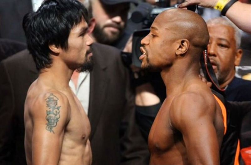 Mayweather and Pacquiao stare each other down.