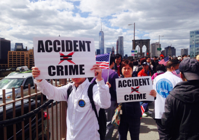 Protesters march across the Brooklyn Bridge protesting the indictment of NYPD officer Peter Liang, who fatally shot unarmed civilian Akai Gurley in November 2014. (Photo credit: Tom Miuccio / PIX11News)