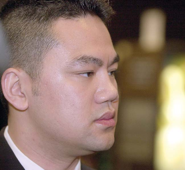 Minneapolis police officer Duy Ngo speaks with reporters during an awards ceremony in which Ngo was presented with a Recognition of Service Award by St. Paul Mayor Randy Kelly on June 7, 2003. Ngo was shot by a suspect and fellow officer Feb. 25, 2003.  (Pioneer Press file photo)