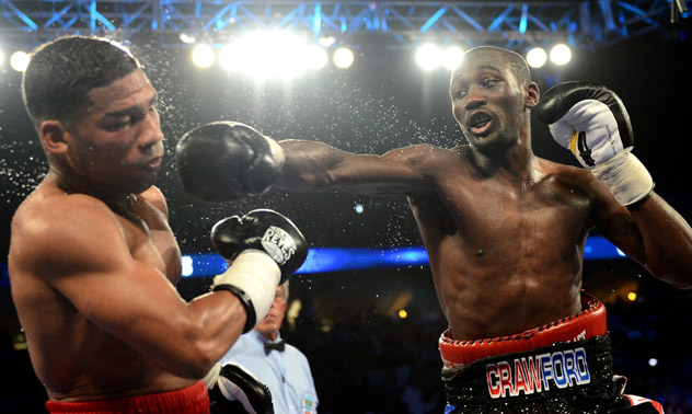Terence Crawford (right) in his 2014 fight against the heavily-favoured Yuriorkis Gamboa (left) last year.