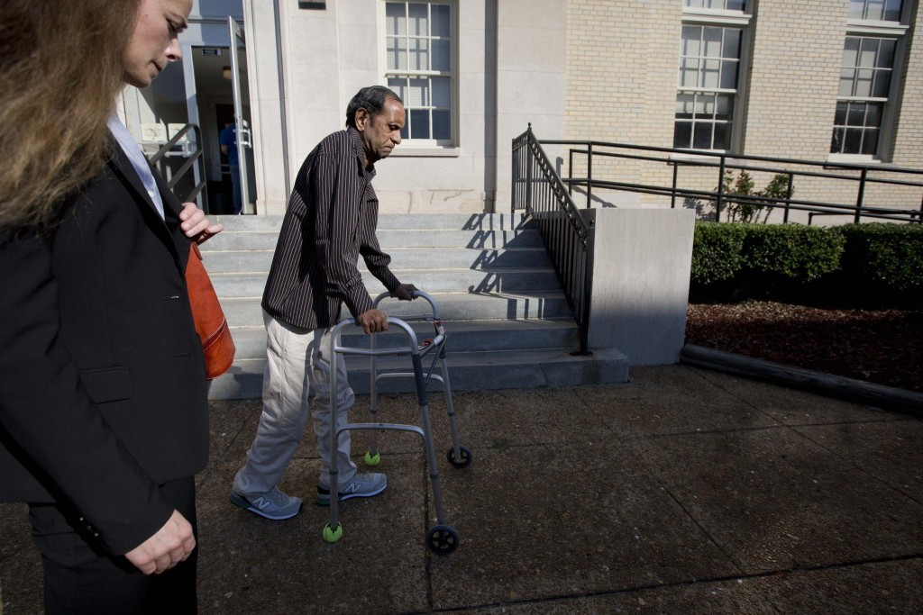 Sureshbhai Patel enters the courthouse in the trial against his assailant, Alabama police officer Eric Parker, who paralyzed Patel following a routine pedestrian stop. (Photo credit: AP/Brynn Anderson)