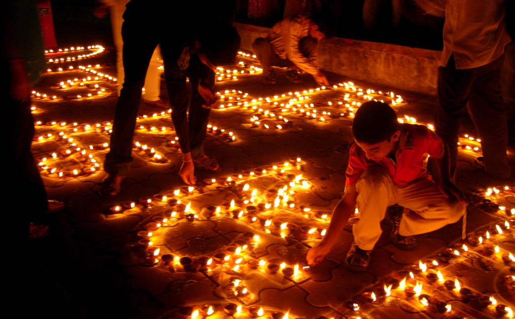 "A child lights candles during Diwali, or the ""Festival of Lights""."
