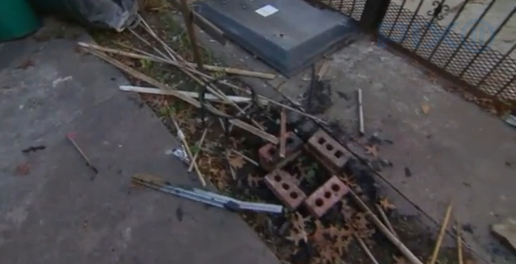 Debris from suspected arson attack. (Photo credit: Screen capture from PIX11 news report)