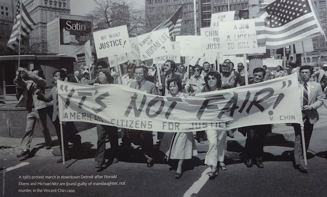 CAPTION: A 1983 protest march in downtown Detroit after Ronald Ebens and Michael Nitz are found guilty of manslaughter, not murder, in the Vincent Chin case. (Photo credit: Corky Lee)