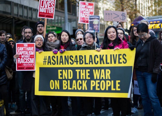 Asian American protesters march in solidarity with Black Lives Matter in New York City in July. (Photo Credit: Unknown / Twitter)