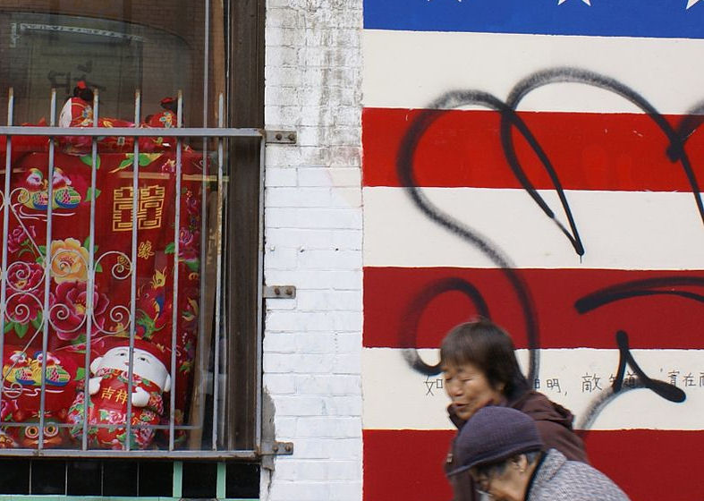Pedestrians walk by a mural of the American flag in San Francisco's Chinatown in February 2007. (Photo credit: Wikimedia Commons)